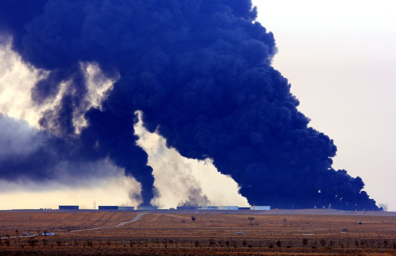 Heavy black smoke rises an oil facility in northern Libya's Ras Lanouf region on January 23, 2016, after it caught fire following attacks launched by Islamic State (IS) group jihadists to seize key port terminals. Firefighters battled a blaze at an oil facility in northern Libya for a third day, an official said, after an assault by jihadists aiming to seize export terminals.   / AFP / STRINGER        (Photo credit should read STRINGER/AFP/Getty Images)