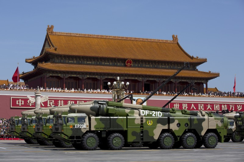 BEIJING, CHINA - SEPTEMBER 03: Chinese military vehicles carrying DF-21D anti-ship ballistic missiles, potentially capable of sinking a U.S. Nimitz-class aircraft carrier in a single strike, drive past the Tiananmen Gate during a military parade to mark the 70th anniversary of the end of World War Two on September 3, 2015 in Beijing, China. China is marking the 70th anniversary of the end of World War II and its role in defeating Japan with a new national holiday and a military parade in Beijing. (Photo by Andy Wong - Pool /Getty Images)