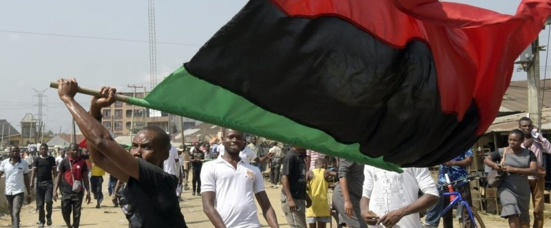 A pro-Biafra supporter waves a flag as people march in Aba, southeastern Nigeria, to call for the release of a key activist on November 18, 2015. The protesters support the creation of a breakaway state of Biafra in the southeast and want the release of Nnamdi Kanu, who is believed to be a major sponsor of the Indigenous People of Biafra (IPOB) and director of the pirate radio station Radio Biafra. AFP PHOTO / PIUS UTOMI EKPEI        (Photo credit should read PIUS UTOMI EKPEI/AFP/Getty Images)
