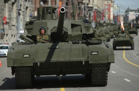 MOSCOW, RUSSIA - MAY 09:  Russian Army T-14 Armata tanks prepare to participate in the annual Victory Parade at Red square as part of celebrations marking the 70th anniversary of the victory over Nazi Germany and the end of World War II on May 9, 2015 in Moscow, Russia. Celebrations are taking place throughout the day across the city. Most European leaders have snubbed the parade because they accuse Russia of actively interfering the war in eastern Ukraine.  (Photo by Sean Gallup/Getty Images)