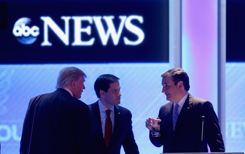 MANCHESTER, NH - FEBRUARY 06:  (L-R) Republican presidential candidates Donald Trump, Sen. Marco Rubio (R-FL) and Sen. Ted Cruz (R-TX) talk during a commercial break in the Republican presidential debate at St. Anselm College February 6, 2016 in Manchester, New Hampshire. Sponsored by ABC News and the Independent Journal Review, this is the final televised debate before voters go to the polls for the New Hampshire primary on February 9.  (Photo by Joe Raedle/Getty Images)