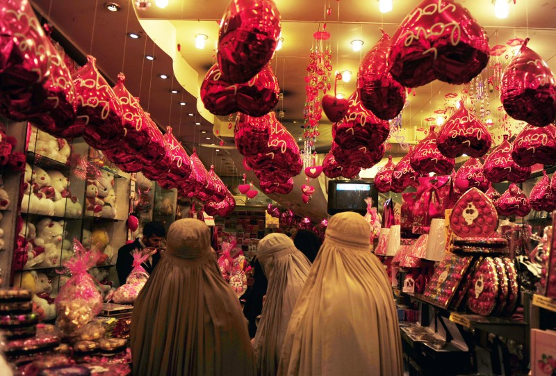 Veiled Pakistani women choose Valentine's Day gifts at a shop in Peshawar on February 11, 2011. A number of shopping centers in Pakistan are full of gifts including cards, stuffed toys, chocolates and miscellaneous items for Valentine's Day celebrated on February 14. AFP PHOTO/ A. MAJEED (Photo credit should read A. MAJEED/AFP/Getty Images)