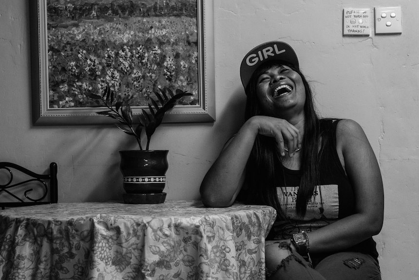 Minarsi having a moment of laughter during mothers day when the residents talk about their children they left back home. She has a son in Indonesia. Bethune House,May 14 2015