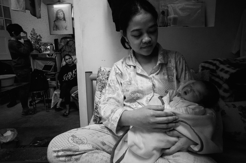 Quennie ,a domestic worker holding her two weeks old son,baby yuan. Yuan was borned 7 months premature in jail. Quenie was accused of stealing an earring and sentenced to jail while pregnant. Bethune House, Hong Kong January 07,2015