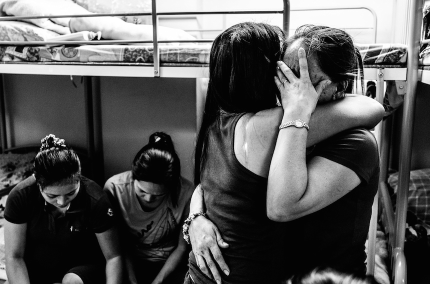 Victims of abuse comfort one another during one of the  sharing sessions at the shelter. A boost of morale is needed when most cases are being delayed and drag too long ;some of them just give up and go home. When a domestic worker file a case,she can not work in HK so she stop sending money for her family back home. Bethune House, Hong Kong October 11,2014