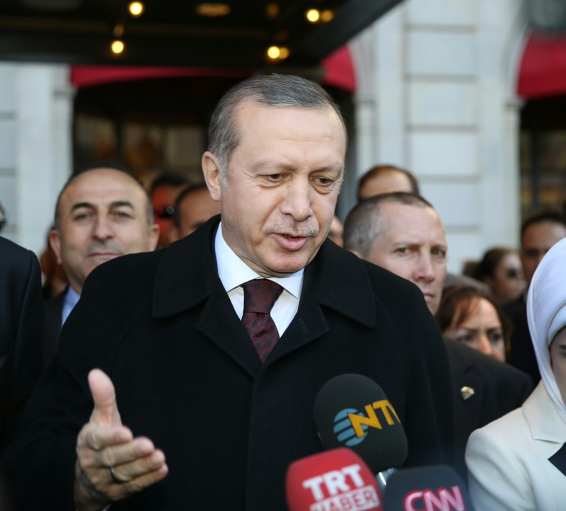 WASHINGTON, USA - MARCH 29: President Recep Tayyip Erdogan speaks to the media as he arrives at the St. Regis Hotel with First Lady Emine Erdoan for the Nuclear Security Summit in Washington, USA on March 29, 2016. Over 50 world leaders are meeting at the Summit this week in Washington.  (Photo by Abdulhamid Hosbas/Anadolu Agency/Getty Images)