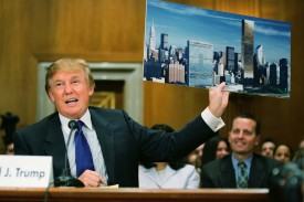 "WASHINGTON - JULY 21:  Donald Trump, president of the Trump Organization, displays a picture of the New York City skyline showing his Trump World Tower (R) near the United Nations as he testifies before the Federal Financial Management, Government Information, and International Security Subcommittee Capitol Hill July 21, 2005 in Washington, DC. The hearing was held on the topic of ""U.S. Financial Involvement in Renovation of UN Headquarters.""  (Photo by Joe Raedle/Getty Images)"