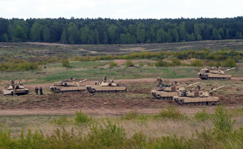 US troops with Abrams tanks exercise at the taining range in Drawsko Pomorskie on May 7, 2015. AFP PHOTO / JANEK SKARZYNSKI        (Photo credit should read JANEK SKARZYNSKI/AFP/Getty Images)