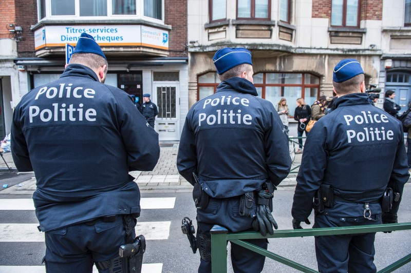 Three police officers stand guard at the Meiser neighbourhood in Schaarbeek - Schaerbeek in Brussels on March 25, 2016 during an anti-terrorist operation searching for suspects of March 22 terrorist attacks in Brussels. Belgian police carrying out a fresh anti-terrorist operation today arrested a suspect, who suffered a slight injury, Schaerbeek Mayor Bernard Clerfayt told AFP. Police sources said the operation was connected to a foiled terror plot in France. / AFP / Belga / LAURIE DIEFFEMBACQ / Belgium OUT        (Photo credit should read LAURIE DIEFFEMBACQ/AFP/Getty Images)