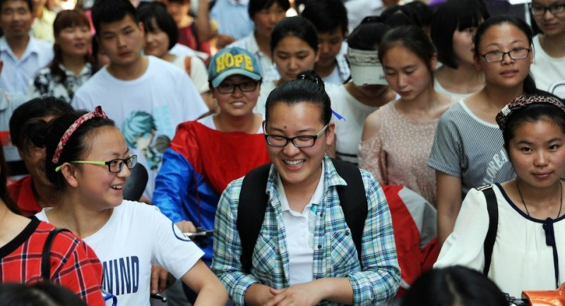 This picture taken on June 8, 2015 shows high school students walking out of a school after sitting the 2015 national college entrance examination, or the ''Gaokao'', in Bozhou, east China's Anhui province. Nearly 10 million high school students sat for China's make-or-break college entrance exams under tight security on June 7 to 8.  AFP PHOTO   CHINA OUT        (Photo credit should read STR/AFP/Getty Images)