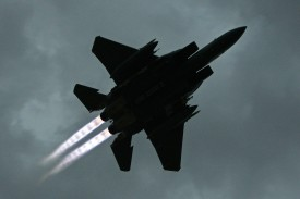 BAGRAM, AFGHANISTAN: A US F-15 E  from 492nd Squadron takes-off at the Bagram Air base in Parwan province, some 50 kms north of Kabul, 26 June 2007. The NATO force in Afghanistan said President Hamid Karzai was right to be angry about civilian casualties in its military operations, and it needed to improve the way it worked. AFP PHOTO/ Nicolas ASFOURI (Photo credit should read NICOLAS ASFOURI/AFP/Getty Images)