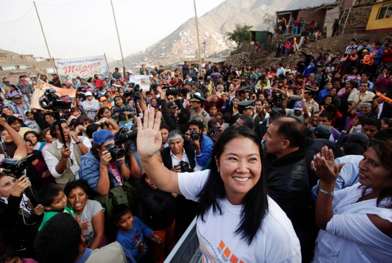 Peruvian presidential candidate Keiko Fujimori waves to supporters as she campaigns on the outskirts of Lima, Peru, on Tuesday, May 17, 2011. Congresswoman Fujimori, who is running even with former army officer Ollanta Humala in polls before today's election, is banking on the votes of those lifted into the middle class by a decade of region-leading economic growth. Photographer: Dado Galdieri/Bloomberg via Getty Images