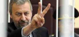 (FILES) Picture taken on May 11, 2011 shows Belarus opposition leader Andrei Sannikov flashing the V-sign for victory in the defendant's cage during his trial. Andrei Sannikov has been pardoned and released from jail, his lawyer Andrei Varvachevitch said on April 14, 2012. AFP PHOTO/ VIKTOR DRACHEV (Photo credit should read VIKTOR DRACHEV/AFP/Getty Images)