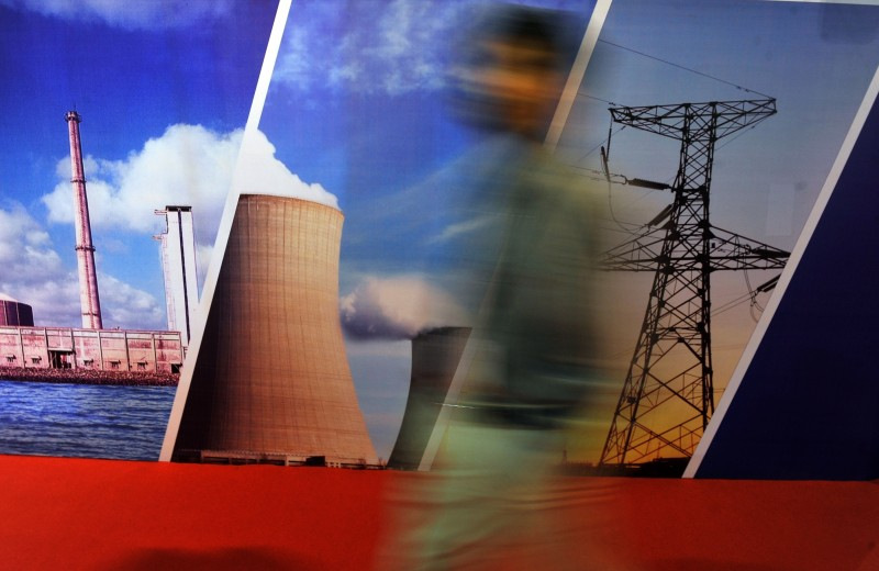 (FILES) In this photograph taken on September 29, 2011, a delegate of the India Nuclear Energy 2011 summit walks past a stall in Mumbai . More than 40 workers at a nuclear power station in northern India have been exposed to tritium radiation in two separate leaks in the past five weeks, company managers said on July 24, 2012. AFP PHOTO/Indranil MUKHERJEE        (Photo credit should read INDRANIL MUKHERJEE/AFP/Getty Images)