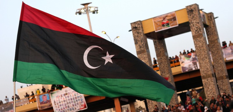 "The new Libyan flag is raised during a parade in the eastern city of Benghazi to celebrate the second anniversary of Nato's first military operation in Libya on March 19, 2013. On 19 March 2011, Kadhafi's troops and tanks entered the city and the same day French forces began an international military intervention in Libya, later joined by coalition forces with strikes against armoured units south of Benghazi and attacks on Libyan air-defence systems, after UN Security Council Resolution 1973 called for using ""all necessary means"" to protect Libyan civilians and populated areas from attack by government forces.  AFP PHOTO / ADBULLAH DOMA        (Photo credit should read ABDULLAH DOMA/AFP/Getty Images)"