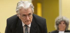 Bosnian Serb wartime leader Radovan Karadzic appears in the courtroom for his appeals judgement at the International Criminal Tribunal for Former Yugoslavia (ICTY) in The Hague, The Netherlands, on July 11 2013. AFP PHOTO/ POOL/MICHAEL KOOREN        (Photo credit should read )