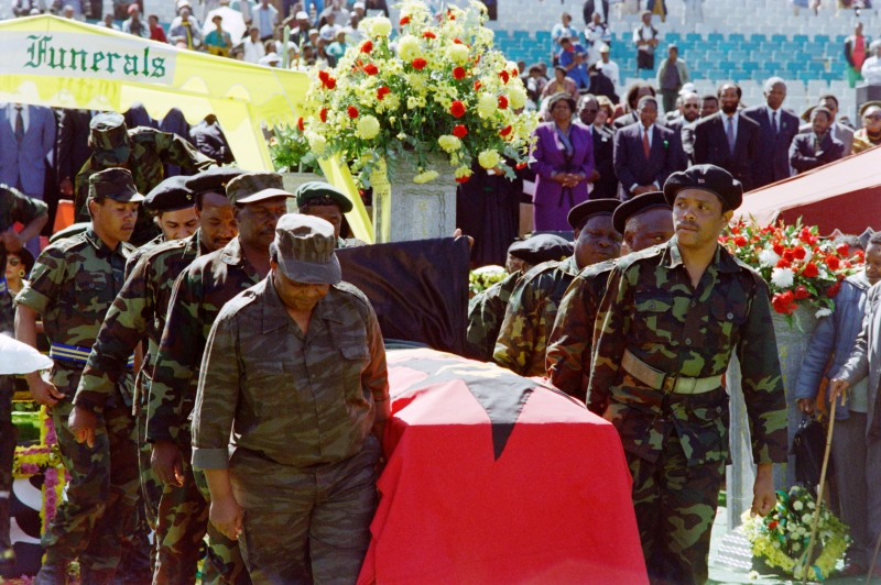 Members of Umkhonto we Sizwe, the ANC military wing , carry the coffin of the assassinated South African Communist Party (SACP) leader Chris Hani, at the vigil in Soweto on April 18, 1993.        (Photo credit should read WALTER DHLADHLA/AFP/Getty Images)