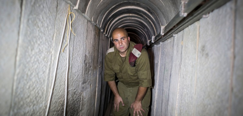 ISRAEL GAZA BORDER, ISRAEL - AUGUST 04:  Israeli soldier seen inside a tunnel built underground by Hamas militants leading from the Gaza Strip into Southern Israel, seen on August 4, 2014 near the Israeli Gaza border, Israel. As Operation Protective Edge enters its 28th day, the Israeli mission of demolishing Hamas tunnels comes to a close and ground forces returned from Gaza, while Israeli airstrikes in Gaza and Hamas rocket fire to Israeli continues. Palestinian groups including envoys of Hamas and Islamic Jihad held their first formal meeting in Cairo hoping to secure a durable ceasefire with Israel.  (Photo by Ilia Yefimovich/Getty Images)
