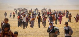 MOSUL, IRAQ - AUGUST 9:  Thousands of Yezidis trapped in the Sinjar mountains as they tried to escape from Islamic State (IS) forces, are rescued by Kurdish Peshmerga forces and Peoples Protection Unit (YPG) in Mosul, Iraq on August 09, 2014. (Photo by )