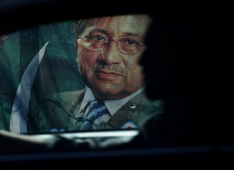 A Pakistani commuter rides past a poster of former military ruler Pervez Musharraf in Rawalpindi on April 1, 2014. A Pakistani court on March 31 indicted Musharraf for treason -- a milestone for civilian authority in a country long dominated by the army.  AFP PHOTO/Farooq NAEEM        (Photo credit should read FAROOQ NAEEM/AFP/Getty Images)