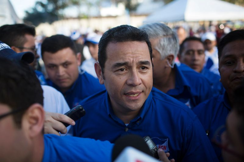 Presidential candidate Jimmy Morales, center, arrives at a campaign rally in Guatemala City, Guatemala, on Thursday, Oct. 22, 2015. Morales, an actor and comedian, leads the race over former First Lady Sandra Torres, according to a poll by ProDatos published in Prensa Libre. Photographer: Saul Martinez/Bloomberg via Getty Images
