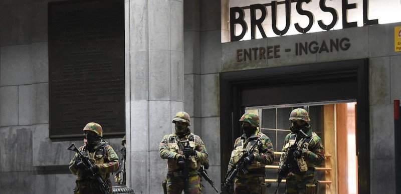Soldiers stand guard in front of the central train station on November 22, 2015 in Brussels, as the Belgian capital remained on the highest security alert level over fears of a Paris-style attack.      / AFP / EMMANUEL DUNAND        (Photo credit should read EMMANUEL DUNAND/AFP/Getty Images)
