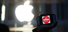 """NEW YORK, NY - FEBRUARY 23: A protestor holds up an iPhone that reads, """"No Entry"""" outside of the the Apple store on 5th Avenue on February 23, 2016 in New York City. Protestors gathered to support Apple's decision to resist the FBI's pressure to build a """"backdoor"""" to the iPhone of Syed Rizwan, one of the two San Bernardino shooters. (Photo by )"""