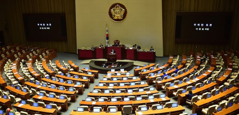 Lee Jong-Kul (C), floor leader of South Korea's main opposition Minjoo Party, speaks as the last speaker of marathon filibuster to call for revision of disputed anti-terrorism bill at the podium of the National Assembly chamber in Seoul on March 2, 2016. South Korean opposition lawmakers on March 2 abandoned a record-breaking filibuster aimed at blocking a bill granting greater surveillance powers to the national spy agency.  AFP PHOTO / JUNG YEON-JE / AFP / JUNG YEON-JE        (Photo credit should read JUNG YEON-JE/AFP/Getty Images)