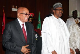 """Nigerian President Muhammadu Buhari (R) and South African President Jacob Zuma arrive for a joint sitting of the National Assembly in Abuja on March 8, 2016. South Africa's President Jacob Zuma began a two-day state visit to Nigeria on March 8, which observers see as an attempt to mend fences between the continent's largest economic powers. Pretoria is putting a positive spin on the visit, talking up the pair's """"good bilateral political, economic and social relations"""" and potential new business opportunities. / AFP / PHILIP OJISUA        (Photo credit should read PHILIP OJISUA/AFP/Getty Images)"""