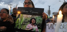 A woman holds a portrait of murdered Honduran Human Rights activist, Coordinator of the Civil Council of Popular and Indigenous Organizations of Honduras (COPINH) Berta Caceres Flores, during an homage on the International Women Day in Tegucigalpa on March 8, 2016.  Caceres was murdered on March 3 in La Esperanza, Honduras.   AFP PHOTO /Orlando SIERRA / AFP / ORLANDO SIERRA        (Photo credit should read ORLANDO SIERRA/AFP/Getty Images)