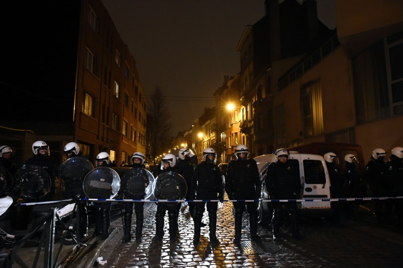 Belgian police forces stand guard in a street during a police action in the Molenbeek-Saint-Jean district in Brussels, on March 18, 2016. A police operation was underway on March 18, in the Brussels area home to key Paris attacks suspect Salah Abdeslam whose fingerprints were found in an apartment raided this week, the federal prosecutor's office said. AFP PHOTO  / JOHN THYS / AFP / JOHN THYS        (Photo credit should read JOHN THYS/AFP/Getty Images)