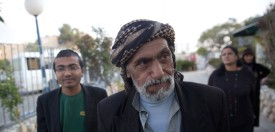 "A Yemeni Jew (C) arrives to an immigration centre in the Israeli city of Beersheba on March 21, 2016 following a secret rescue operation to evacuate a group of 19 Jews from war-torn Yemen to Israel.    Israel has spirited 19 Jews out of war-torn Yemen in a ""covert operation"" to rescue some of the last remnants of one of the world's most ancient Jewish communities, officials said. The operation transporting them to Israel almost brings to an end the Jewish community in Yemen, which once numbered around 60,000 people and dates back some 2,000 years.   / AFP / MENAHEM KAHANA        (Photo credit should read"