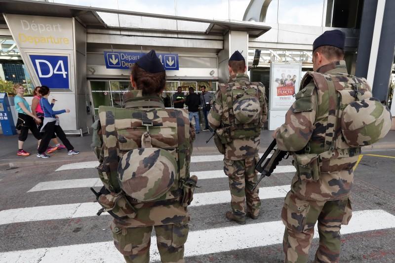 French troops patrol at the international airport of the French Riviera city of Nice on March 22, 2016.  Belgium's neighbours France, Germany and the Netherlands tightened border security after the attacks on Brussels airport and metro system that left at least 26 dead. / AFP / VALERY HACHE        (Photo credit should read VALERY HACHE/AFP/Getty Images)