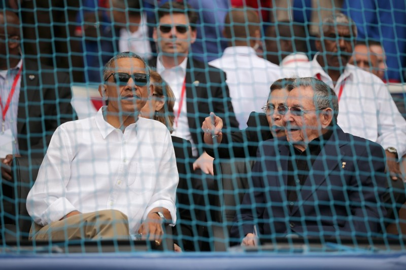 U.S. President Barack Obama and Cuban President Raul Castro arrive for an exposition game between the Cuban national team and the Major League Baseball team Tampa Bay Devil Rays at the Estado Latinoamericano March 22, 2016 in Havana, Cuba. This is the first time a sittng president has visited Cuba in 88 years.