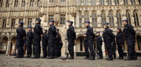 Belgian police officers stand guard at the Grand Place in Brussels on March 23, 2016, a day after blasts hit the Belgian capital. World leaders united in condemning the carnage in Brussels and vowed to combat terrorism, after Islamic State bombers killed 31 people in a strike at the symbolic heart of the EU. AFP PHOTO / KENZO TRIBOUILLARD / AFP / KENZO TRIBOUILLARD        (Photo credit should read )