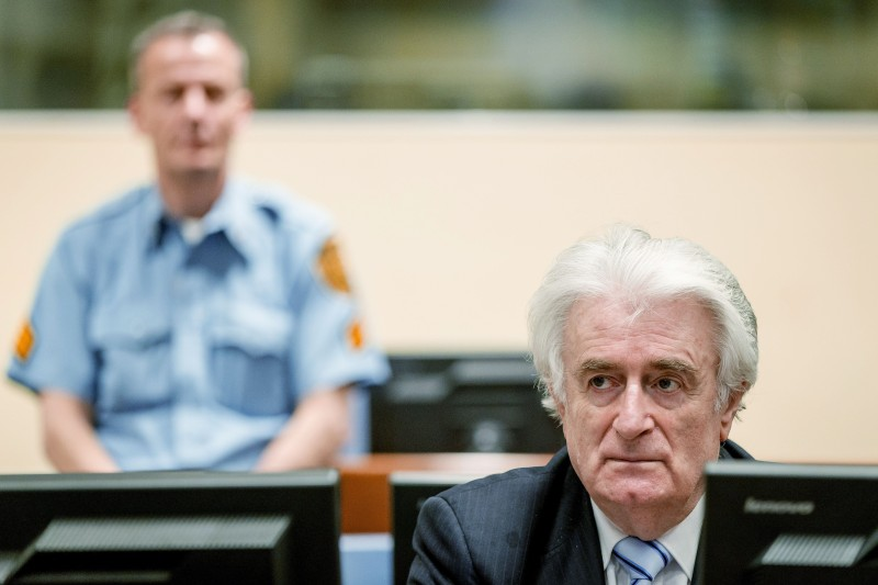 Bosnian Serb wartime leader Radovan Karadzic sits in the courtroom for the reading of his verdict at the International Criminal Tribunal for Former Yugoslavia (ICTY) in The Hague, on March 24, 2016. The former Bosnian-Serbs leader is indicted for genocide, crimes against humanity, and war crimes.  / AFP / POOL / Robin van Lonkhuijsen / Netherlands OUT        (Photo credit should read ROBIN VAN LONKHUIJSEN/AFP/Getty Images)