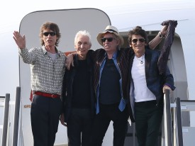 HAVANA, CUBA - MARCH 24:  Mick Jagger, Charlie Watts, Keith Richards and Ronnie Wood of the Rolling Stones wave as they exit their plane after landing at the Jose Marti International Airport on March 24, 2016 in Havana, Cuba. The Rolling Stones are in Havana to play a free concert for the first time, after the music was once banned by the Cuban government.  (Photo by Joe Raedle/Getty Images)