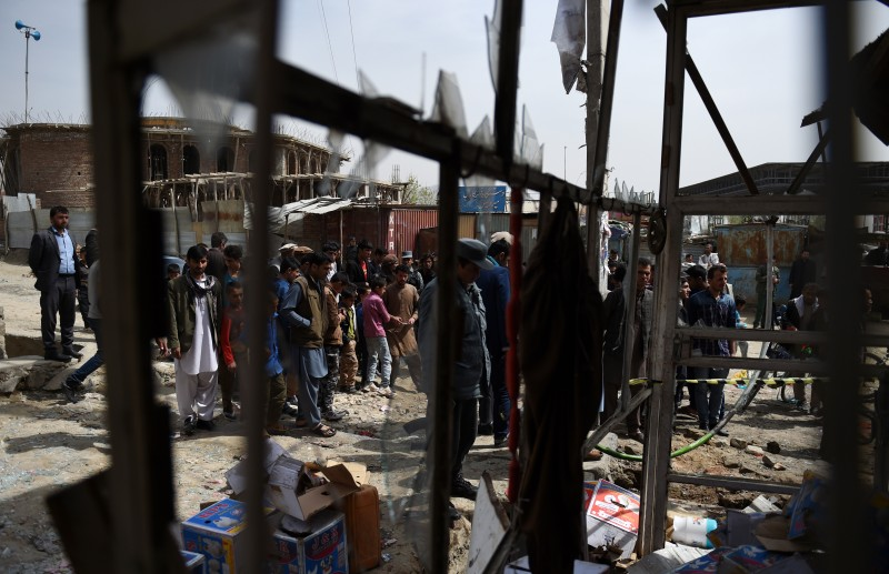 Afghan residents gather at the scene of a roadside bomb explosion at Khair Khana in Kabul on March 29, 2016. A roadside bomb attack in a residential area of Kabul killed two civilians and wounded nine people, Sediq Sediqqi, the Spokesperson to the Afghan Ministry of Interior Affairs, said. / AFP / WAKIL KOHSAR        (Photo credit should read WAKIL KOHSAR/AFP/Getty Images)