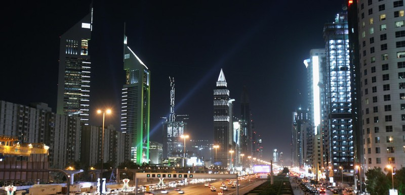 DUBAI, UNITED ARAB EMIRATES - DECEMBER 03:  A general view is seen of the iconic Emirates Towers and Sheik Zayhed Road on December 3, 2007 in Dubai, United Arab Emirates. The towers have been lit up this week to celebrate the 36th UAE National Day. Pakistani and Indian labourers form the backbone of a workforce that over the last few years has transformed Dubai in to a futuristic city that now boasts the tallest building in the world (the Burj Dubai). However, life is hard and many of the workers live in poor conditions in labour camps in areas such as Sharjar and Al-Quoz. This exponential growth in the construction industry has led to problems such as excess traffic and congestion. A metro line is due to be completed in 2008 in an attempt to alleviate the problem.  (Photo by Chris Jackson/Getty Images)