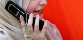 BAGHDAD, IRAQ - JUNE 26: An Iraqi woman uses a mobile phone on June 26, 2008 in Baghdad, Iraq. The war-damaged aging landline telephone infrastructure means Iraqis are increasingly more dependent on mobile phones in daily life and business.  (Photo by Wathiq Khuzaie/Getty Images)