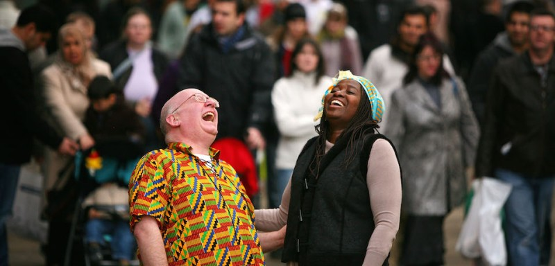 Laughter consultant Robin Graham and Abena Agyeman attempt to bring smiles and happiness to shoppers in Manchester city centre as part of the world laughter pledge on January 24, 2009 in Manchester, England.  Graham is launching the World Laughter Pledge, an attempt to make everyone in the world laugh together every Saturday at 9am in their respective time zone. Robin hopes that through his website, www.worldlaughterpledge.org, the  laughter wave will ripple around the world bringing happiness and peace.