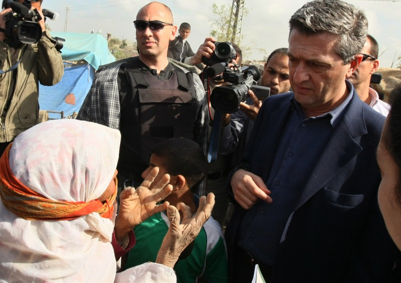 The new head of the UN agency for Palestinian refugees (UNRWA), Filippo Grandi of Italy (R) listens to a Palestinian woman during a visit to an area in the central Gaza Strip which was recently flooded following heavy rains, on February 2, 2010. Israel's military has reprimanded two senior officers for the firing of shells, which contained white phosphorous, in a populated area near a UN compound during the Gaza war, the army said. AFP PHOTO/MAHMUD HAMS (Photo credit should read MAHMUD HAMS/AFP/Getty Images)