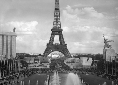 View taken 20 August 1937 from the Trocadero of the Eiffel Tower during the 1937 World exhibition, or Exposition Internationale des Arts et Techniques dans la Vie Moderne (International Exposition dedicated to Art and Technology in Modern Life) which was held in Paris. Facing each other, are the German pavilion (L), conceived by architect Albert Speer, with the symbols of the Nazi state, an eagle and the swastika, and the Soviet Union pavilion (R), built by Boris Iofan and topped with a gigantic statue of a male worker and a female peasant, their hands thrusting a hammer and a sickle together (Labourer and Kolkhoz Woman, by Vera Mukhina), in a symbol of communist union. Both Speer and Iofan were awarded gold medals for their respective designs. AFP PHOTO (Photo credit should read OFF/AFP/Getty Images)