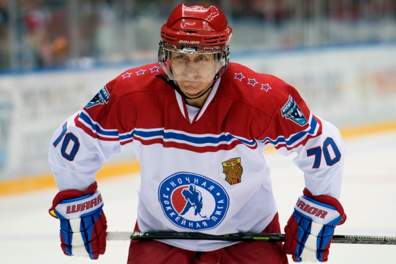 epa04751818 Russian President Vladimir Putin looks on during a gala ice hockey match between Russian amateur players and ice hockey stars during the Night Hockey league tournament in the Black Sea resort of Sochi, Krasnodar region, Russia,16 May 2015.  EPA/YEVGENY REYTOV