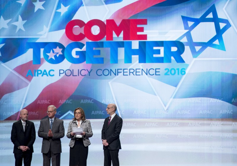 AIPAC leadership, including President Lillian Pinkus (2nd R), make a statement rejecting comments made the previous day by Republican Presidential candidate Donald Trump about US President Barack Obama, during the American Israel Public Affairs Committee (AIPAC) 2016 Policy Conference at the Washington Convention Center in Washington, DC, March 22, 2016. / AFP / SAUL LOEB        (Photo credit should read SAUL LOEB/AFP/Getty Images)