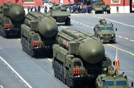 A Russian Yars RS-24 intercontinental ballistic missile system drives during the Victory Day military parade in Moscow on May 9, 2015. Russian President Vladimir Putin presides over a huge Victory Day parade celebrating the 70th anniversary of the Soviet win over Nazi Germany, amid a Western boycott of the festivities over the Ukraine crisis. AFP PHOTO / POOL / HOST PHOTO AGENCY RIA NOVOSTI        (Photo credit should read -/AFP/Getty Images)