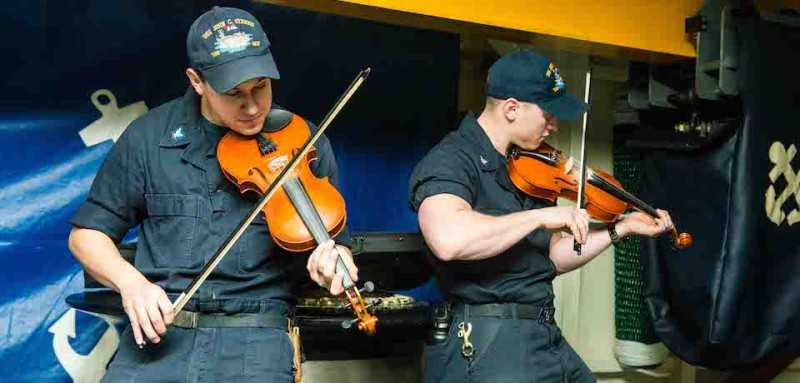 160116-N-MY174-032  PACIFIC OCEAN (Jan. 16, 2016) Boatswain Mates 3rd Class Jakob Schmidt from Eugene and Dave Del Rio practice playing violin in USS John C. Stennis' (CVN 74) forecastle. Providing a combat-ready force to protect collective maritime interests, Stennis is operating in the U.S. 3rd Fleet area of operations for a regularly scheduled Western Pacific deployment. (U.S. Navy photo by Mass Communication Specialist Seaman Tomas Compian/Released)