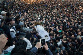 SRINAGAR, INDIA - OCTOBER 29: Kashmiri villagers carry the body of top Lashkar-e-Taiba commander Abu Qasim during his funeral procession on October 29, 2015 in Bugam district Kulgam some 75 km from Srinagar, India. Police on Thursday claimed that the most wanted LeT Commander Abu Qasim was killed during an encounter in Khandaypora area of Kulgam district, south Kashmir. (Photo by Waseem Andrabi/Hindustan Times via Getty Images)