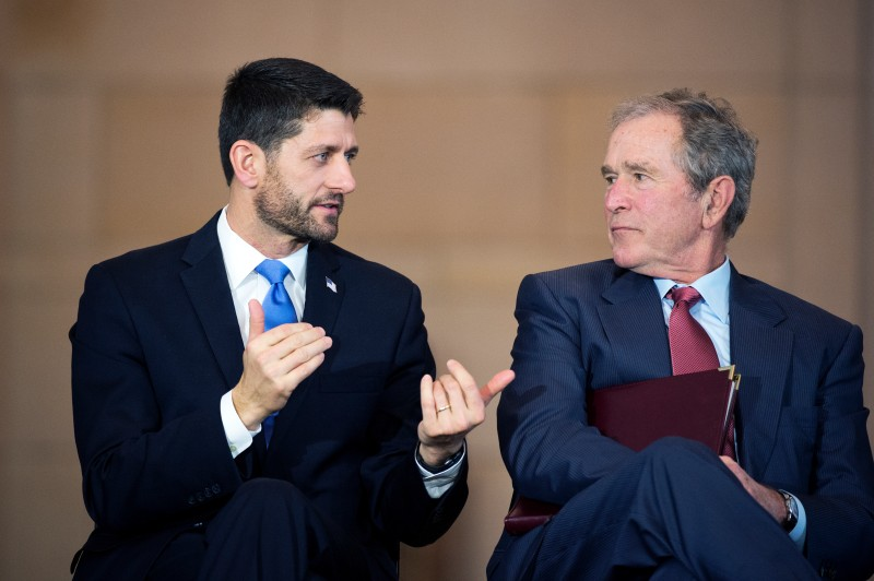 UNITED STATES - DECEMBER 03: Speaker Paul D. Ryan, R-Wis., left, and former President George W. Bush attend a bust unveiling ceremony for former Vice President Dick Cheney in the Capitol Visitor Center's Emancipation Hall, December 3, 2015. (Photo By Tom Williams/CQ Roll Call)