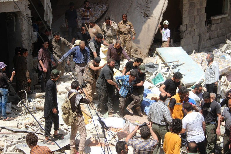 ALEPPO, SYRIA - APRIL 28:  Civilians look for survivors under debris after Russian forces staged air-strike over Aleppo's opposition controlled Kellase region, Syria on April 28, 2016.  (Photo by Ibrahim Ebu Leys/Anadolu Agency/Getty Images)